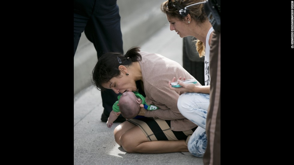 "<a href=""http://www.cnn.com/2014/02/21/us/florida-baby-cpr/index.html"">Pamela Rauseo performs CPR</a> on her 5-month-old nephew after pulling her vehicle over on the side of the road February 20 in Miami. Lucila Godoy, right, stopped to assist. The baby was taken to a nearby hospital, where he was in critical condition but expected to survive, his aunt said the next day."