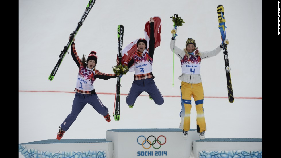 From left, silver medalist Kelsey Serwa of Canada, gold medalist Marielle Thompson of Canada, and bronze medalist Anna Holmlund of Sweden celebrate on the podium after the women's ski cross competition on February 21.