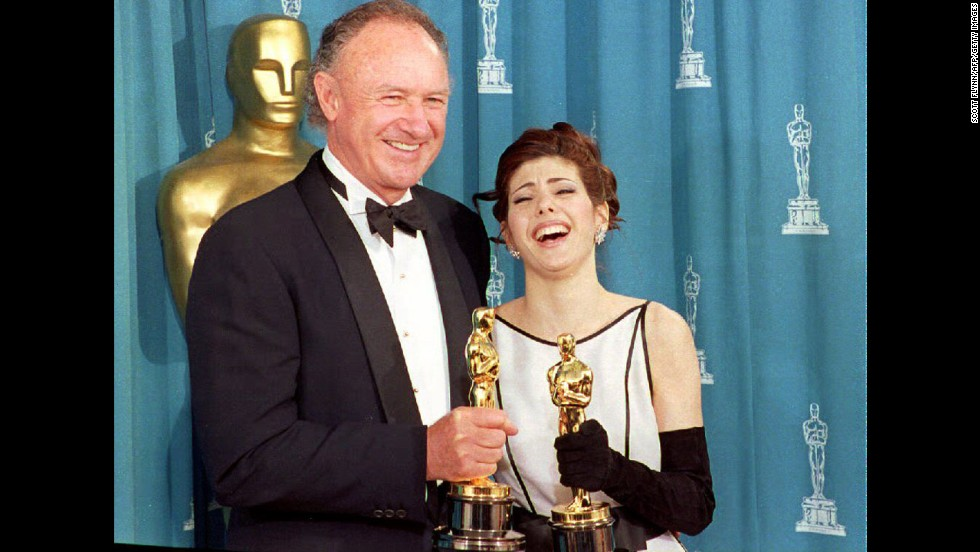 "Gene Hackman poses with Marisa Tomei in 1993 after he wins an Oscar for best supporting actor for his role in ""Unforgiven"" and she wins for best supporting actress for ""My Cousin Vinny."" Tomei's win is totally unexpected and still sometimes<a href=""http://blogs.amctv.com/movie-blog/2008/07/my-cousin-vinny-marisa-tomei/"" target=""_blank""> (wrongly) contested.</a>"