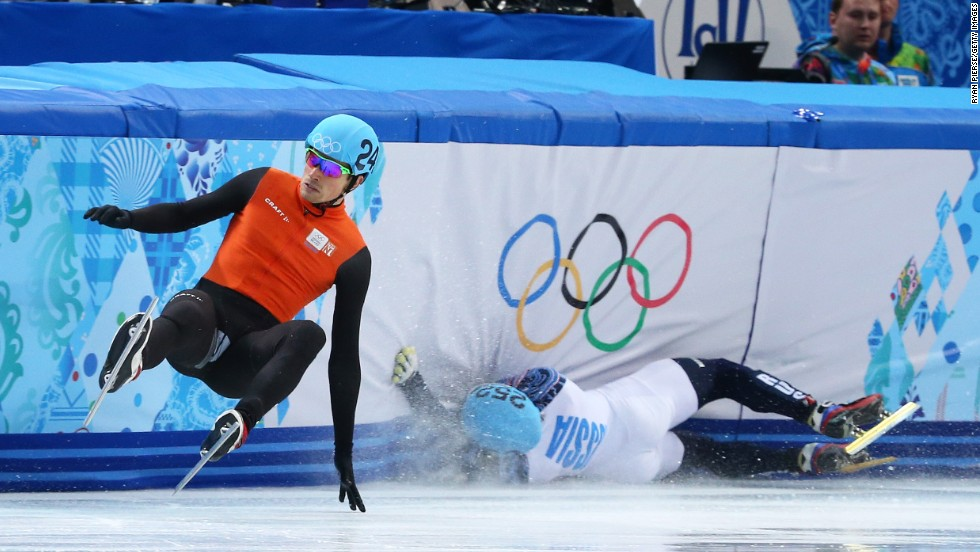 Vladimir Grigorev of Russia, right, hits the wall while Freek van der Wart of the Netherlands falls in a 500-meter short track race February 21.