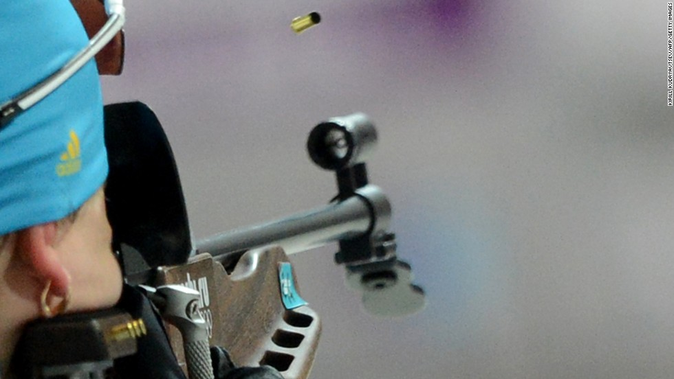 Ukrainian biathlete Olena Pidhrushna fires her rifle on her way to winning the gold medal in the team relay.