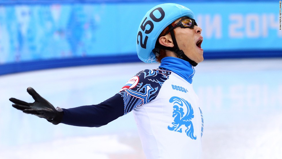 Victor An of Russia celebrates winning the gold medal in the short track 5,000-meter relay on February 21.