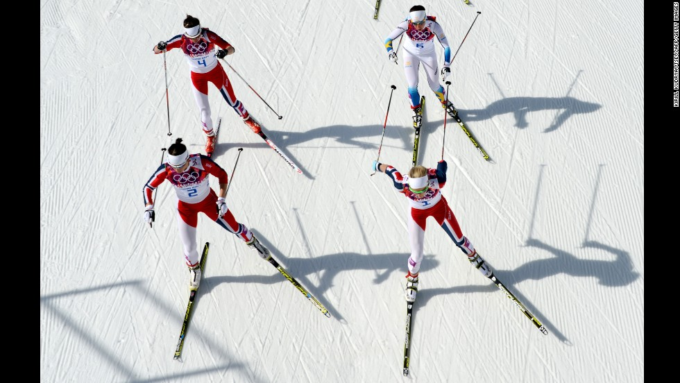 Norway's Marit Bjoergen, front left, and Norway's Therese Johaug are followed by Norway's Heidi Weng and Sweden's Charlotte Kalla on February 22 as they compete in the women's cross-country skiing 30-kilometer mass start free.