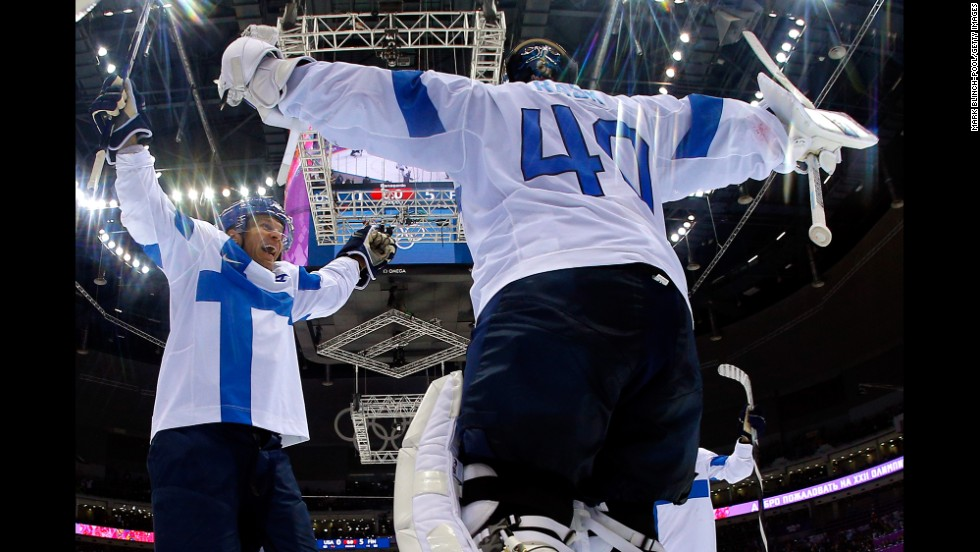 Finland's Tuukka Rask and Kimmo Timonen  celebrate after defeating the United States to take the bronze in men's ice hockey on February 22.