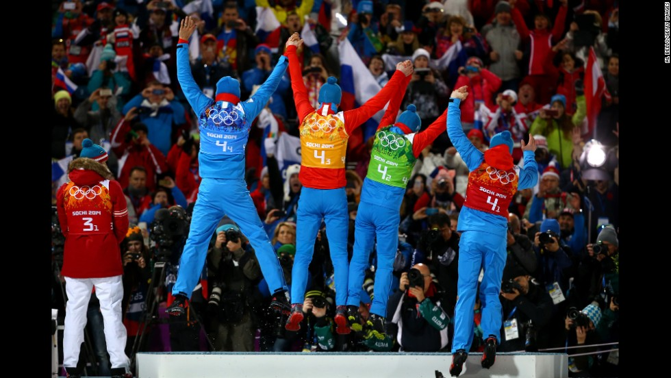 Gold medalists Anton Shipulin, Dmitry Malyshko, Evgeny Ustyugov and Alexey Volkov of Russia celebrate on the podium during the medal ceremony for the men's 4x7.5-kilometer relay.