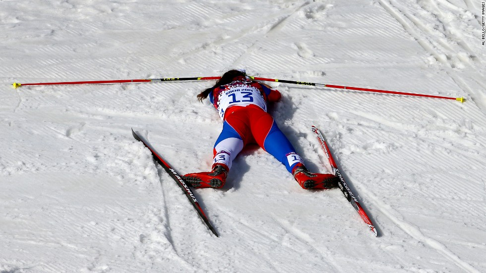 Eva Vrabcova-Nyvltova of the Czech Republic collapses on February 22 after the women's 30-kilometer mass start free cross-country event.
