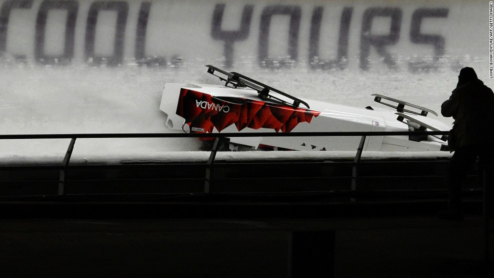 The Canadian team slides down the course upside down after the crash on February 22.