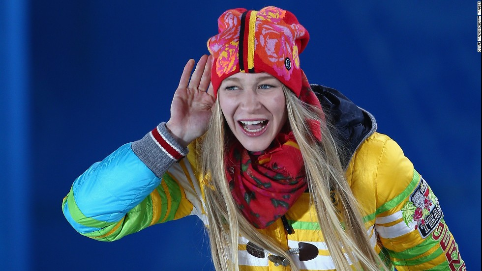 Amelie Kober of Germany, who got the bronze in ladies' snowboard parallel slalom, celebrates during the medal ceremony on February 22.