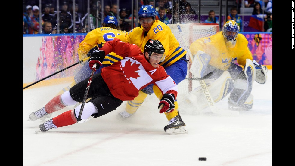 Canada's Jonathan Toews and Sweden's Alexander Steen chase the puck during the gold medal game on February 23.