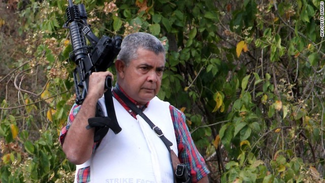 Venezuelan opposition Army General Angel Vivas Perdomo remains armed at his house in Caracas on February 23, 2014.