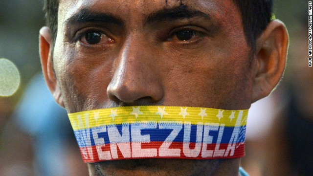 A man attends a protest against the government of Venezuelan President Nicolas Maduro in Caracas on February 23, 2014.