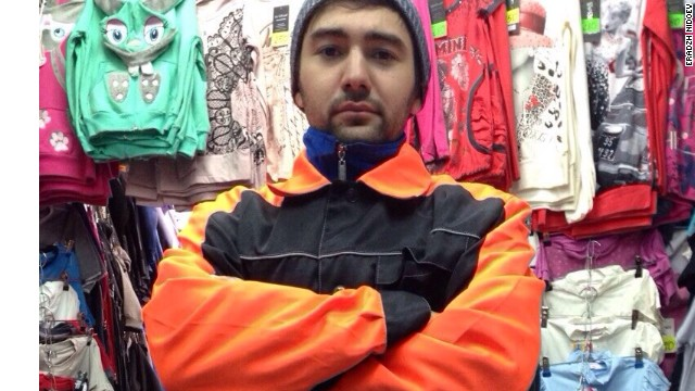 Eradzh Nidoev dressed for duty as a market worker