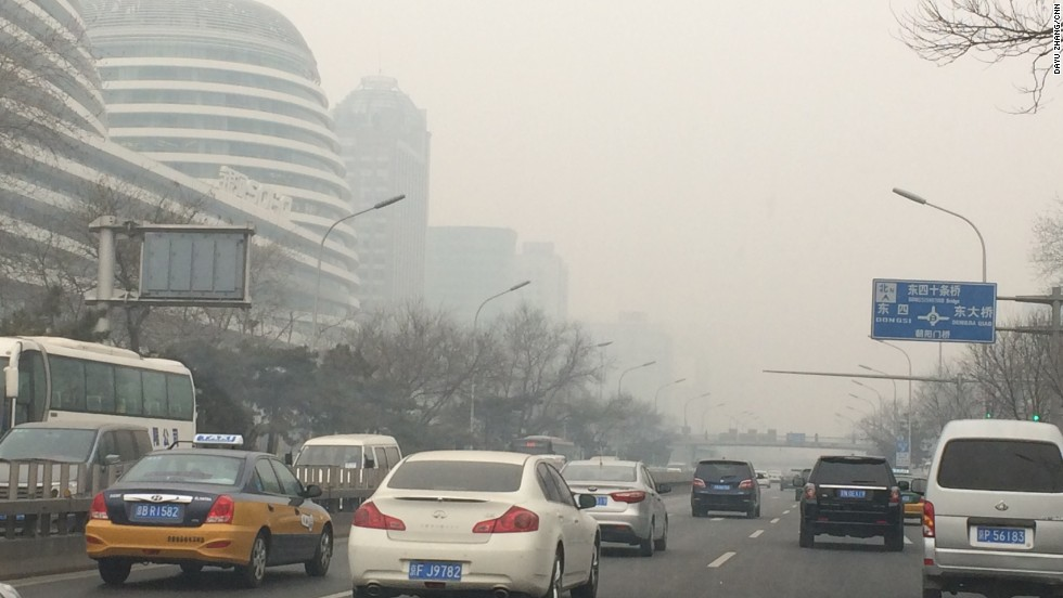 Smog blankets Beijing traffic -- a regular experience in the Chinese capital in recent times.