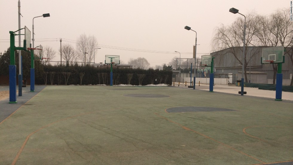 Basketball courts in the city lie deserted as pollution levels reach dangerous levels.