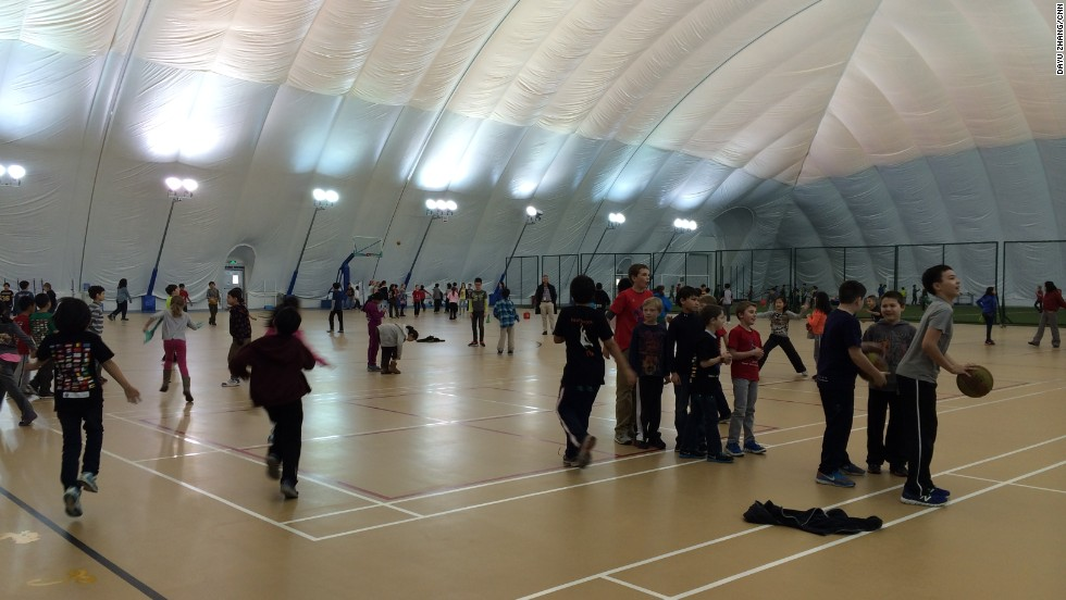 Students spend their break times under the school's clean-air dome.