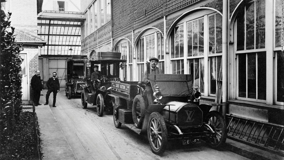 Delivery cars with the famous LV logo are parked in front of the factory in 1909.