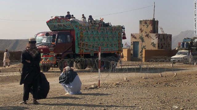 Pakistani tribal families flee after airstrikes on Taliban hideouts in North Waziristan on February 24, 2014.