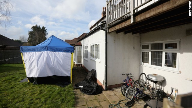 A police forensic tent sits in the garden of Moazzam Begg's house in Birmingham, England.