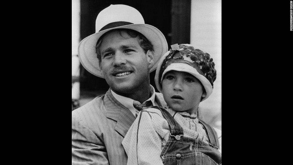 "Tatum O'Neal, being held by father Ryan, is the youngest winner of an acting category. She was 10 when she won best supporting actress for ""Paper Moon"" (1973)."