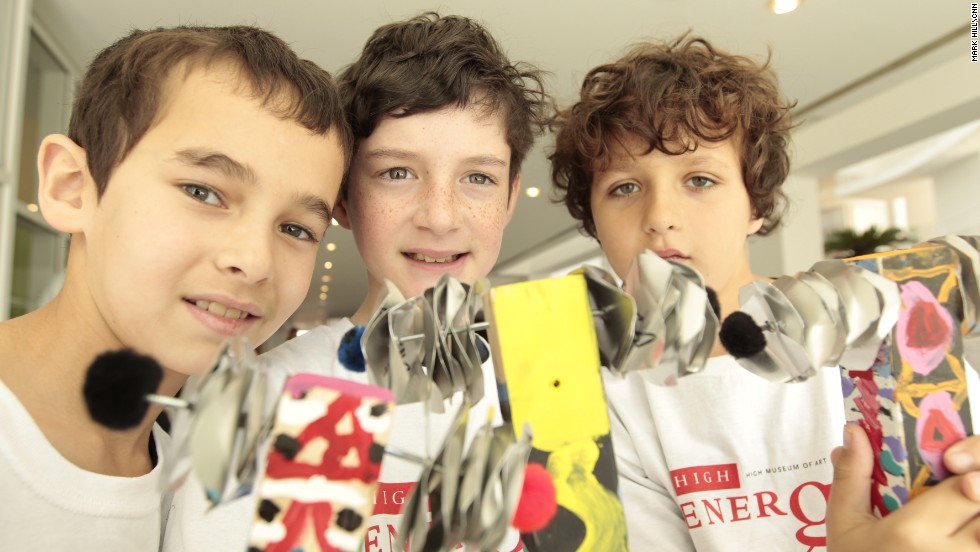 A group of fourth grade students -- from left, Charlie Marks, Bennett Pollack and Adam Arkin -- learns about rhythm on instruments they created themselves with the help of a Galloway art teacher.