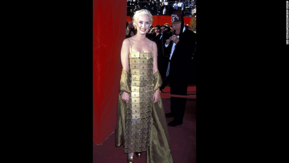 "On one hand, Lizzy Gardiner's dress of American Express Gold Cards is certainly ... inspired. The costume designer crafted her own gown in 1995, when she won the best costume design Oscar for ""Priscilla, Queen of the Desert."" But c'mon, Lizzy -- if you could afford that gold wrap, you could afford enough fabric for an actual dress."