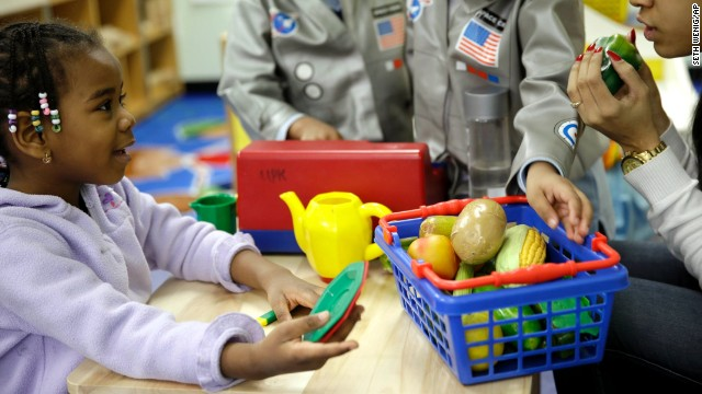 Oumou Balde, 4, left, takes part in a pre-kindergarten nutrition program in New York.