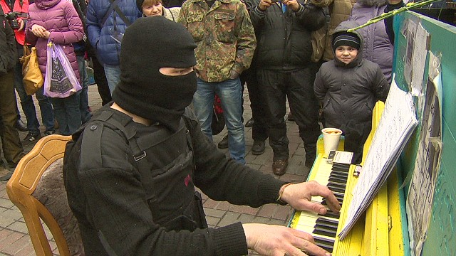 pkg black ukraine piano man_00012614.jpg