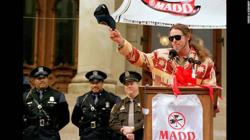Nugent salutes a crowd in Lansing, Michigan, during a sober driving event sponsored by Mothers Against Drunk Driving in 1999.