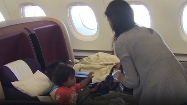 Delta to breast-feeding mom: Cover up