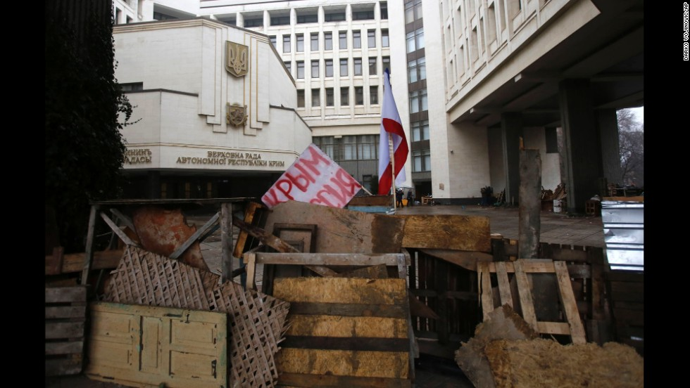 "Barricades in front of a government building in Simferopol on February 27 hold a banner that reads: ""Crimea Russia."" There's a broad divide between those who support the pro-Western developments in Kiev and those who back Russia's continued influence in Crimea and across Ukraine."