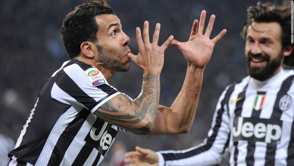 Juventus striker Carlos Tevez, left, celebrates with teammate Andrea Pirlo after scoring against Torino during a Serie A soccer match in Turin, Italy, on Sunday, February 23.