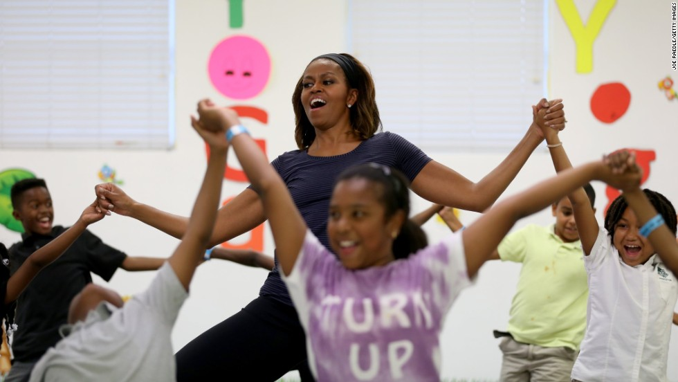 First lady Michelle Obama participates in a yoga class with children in Miami on Tuesday, February 25. This week marked the fourth anniversary of her Let's Move campaign, which fights childhood obesity.
