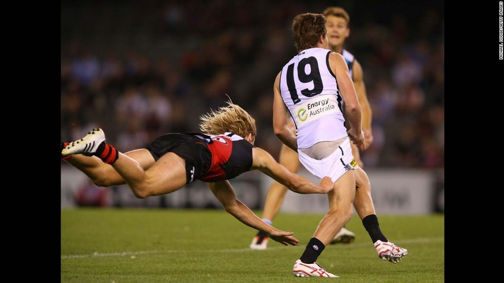 Dyson Heppell of Essendon tackles Matt White of Port Adelaide during an Australian rules football match in Melbourne on Tuesday, February 25.