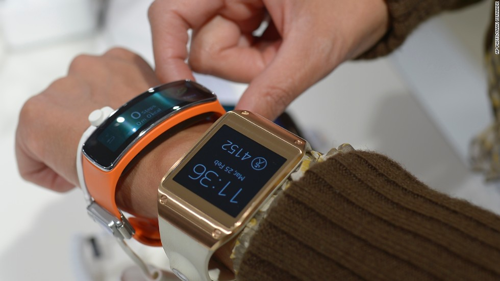Samsung Gear 2, right, and at the Samsung Gear Fit. Like the Galaxy S5 smartphone, they came with the new ability to constantly monitor your heart rate, making them far more useful as training aids.