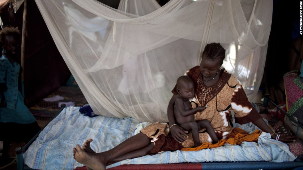 "A Nuer woman rests on a bed with her son in a camp for internally displaced people in Bor, South Sudan, on Thursday, February 27. <a href=""http://www.cnn.com/2014/02/01/world/africa/south-sudan-aid-workers/index.html"">Violence has quickly spread</a> throughout the country since rebels loyal to ousted Vice President Riek Machar tried to stage a coup in mid-December."