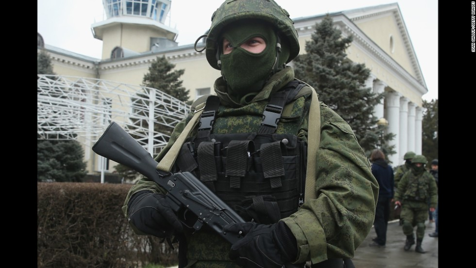 An armed man wearing no identifying insignia patrols outside Simferopol International Airport on February 28.