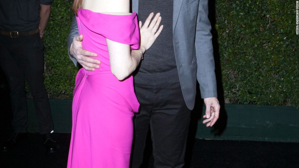 "Oscar nominee Amy Adams arrives at a celebration for ""American Hustle"" with her partner Darren Le Gallo on February 27."