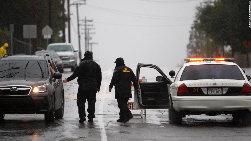 A roadblock in Glendora, California, keeps people from entering an evacuated neighborhood as a storm brings rain February 28 in the midst of record drought.