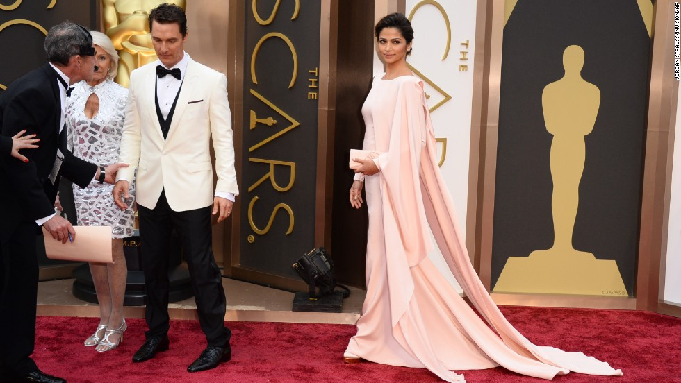 Matthew McConaughey and his wife, Camila Alves, right