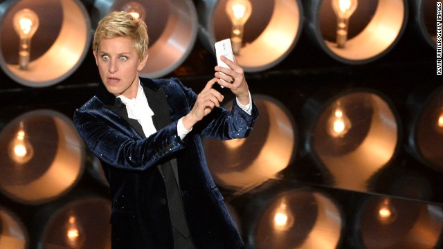 DeGeneres takes a selfie on stage near the start of the show.
