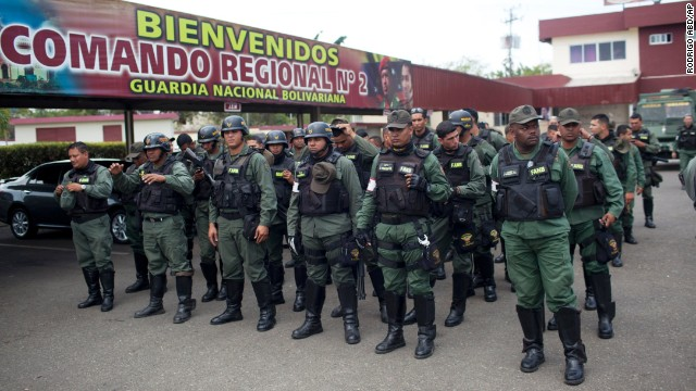 Bolivarian National Guard officers stand in formation after a patrol in Valencia on Saturday, March 1.