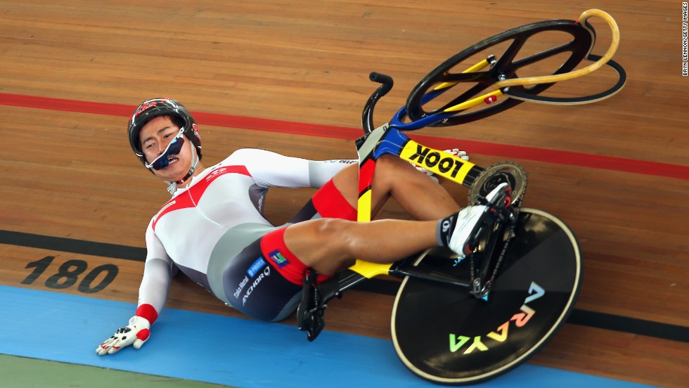Yuta Wakimoto of Japan slides down the track after crashing during the keirin competition Wednesday, February 26, at the UCI Track Cycling World Championships in Cali, Colombia.