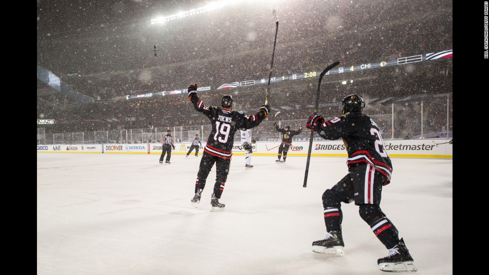 Jonathan Toews of the Chicago Blackhawks reacts after scoring his second goal of the night against the Pittsburgh Penguins on Saturday, March 1. The game was held outdoors at snowy Soldier Field in Chicago.