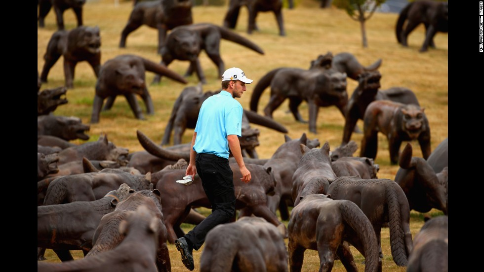 David Klein walks on the 18th hole of The Hills Golf Club during the final round of the New Zealand Open on Sunday, March 2. The course, in Queenstown, New Zealand, is adorned with sculptures of a sword-wielding warrior and 110 wolves.