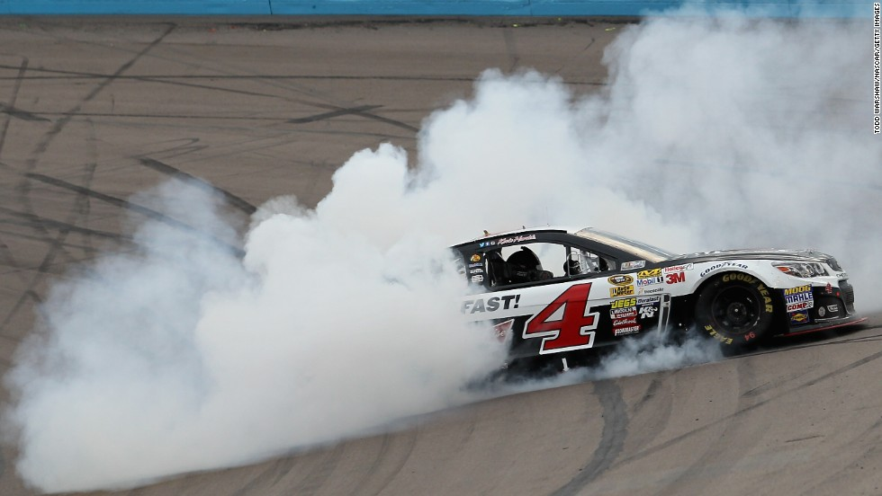 Kevin Harvick celebrates with a burnout after winning the NASCAR Sprint Cup race at Phoenix International Raceway on Sunday, March 2.