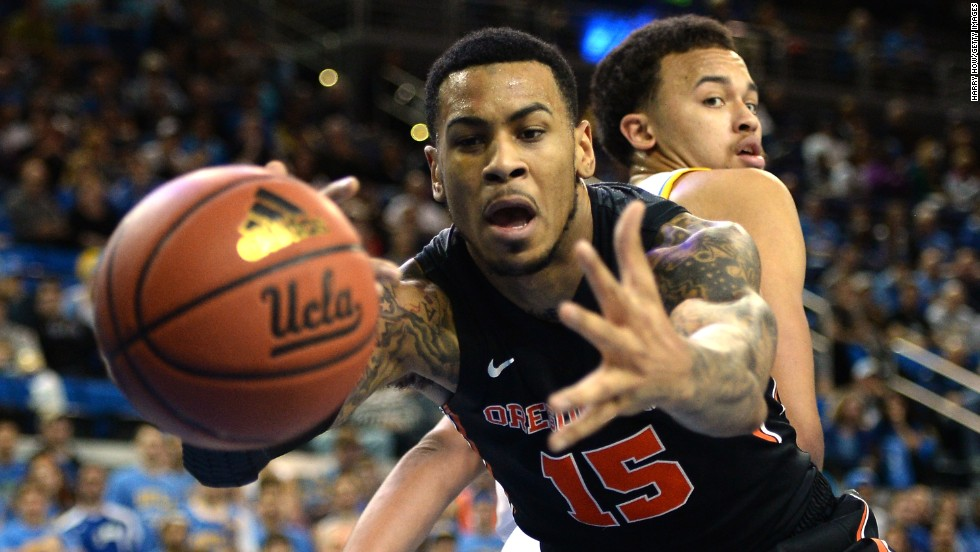 Eric Moreland of the Oregon State Beavers loses the ball as Kyle Anderson of the UCLA Bruins looks back during the first half of their game Sunday, March 2, in Los Angeles.