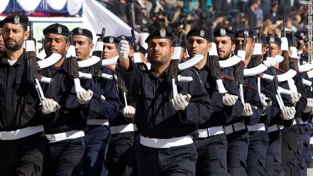 Palestinian Hamas policemen march during a graduation ceremony in Gaza City on January 29, 2014.