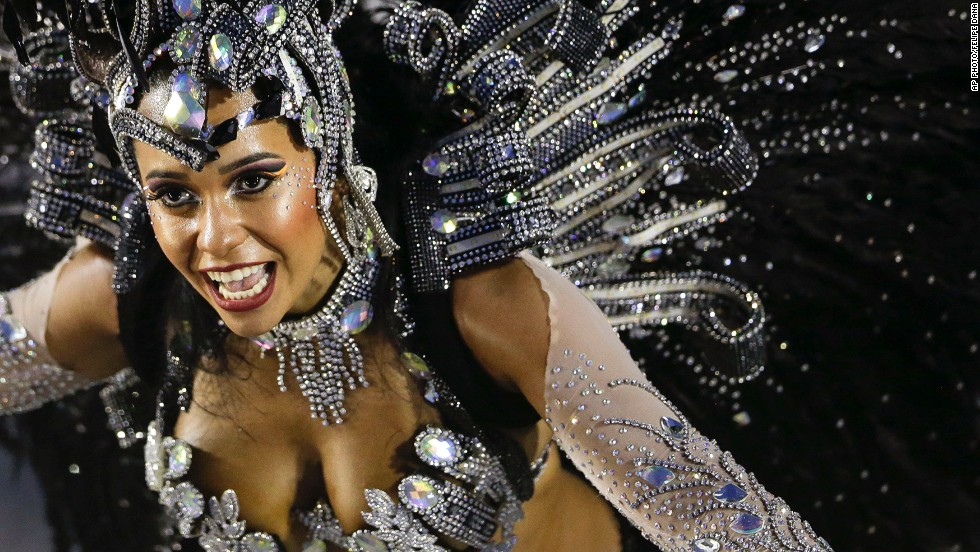 "MARCH 4 - RIO DE JANEIRO, BRAZIL: A performer from the Beija-Flor samba school parades during carnival celebrations at the Sambadrome -- a competition between dance schools -- on March 3. <a href=""http://cnn.com/video/data/2.0/video/world/2014/03/03/wbt-pkg-darlington-brazil-rio-carnival.cnn.html"">Watch as CNN's Shasta Darlington follows the colorful procession. </a>"