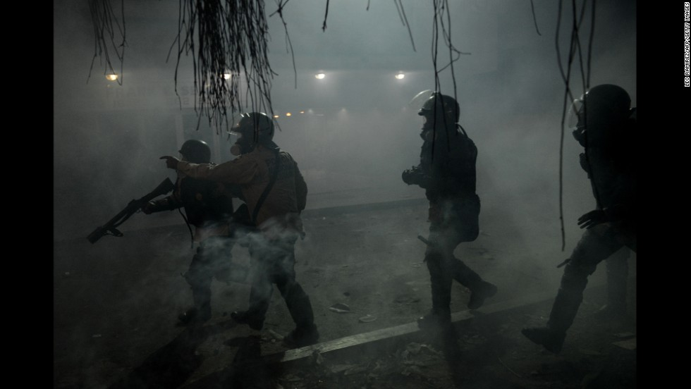 National Guard members throw tear gas canisters toward opposition activists in Caracas on March 3.