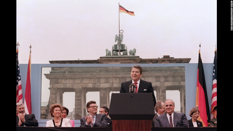 "President Reagan, commemorating the 750th anniversary of Berlin, addresses the people of West Berlin at the base of the Brandenburg Gate, near the Berlin Wall on June 12, 1987. Due to the amplification system being used, the President's words could also be heard on the Eastern (communist-controlled) side of the wall. ""Tear down this wall!"" was the famous appeal by Reagan, directed at Gorbachev, to destroy the Berlin Wall. The address Reagan delivered that day is considered by many to have affirmed the beginning of the end of the Cold War and the fall of the Soviet bloc."